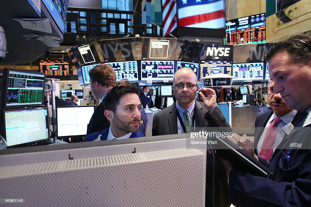 Traders work on the floor of the New York Stock Exchange on February 27, 2013 in New York City. Following more positive housing data and encouraging signals from the chairman of the Federal Reserve, the Dow Jones industrial average rallied 175 points to finish the day at its highest level since October 2007.
