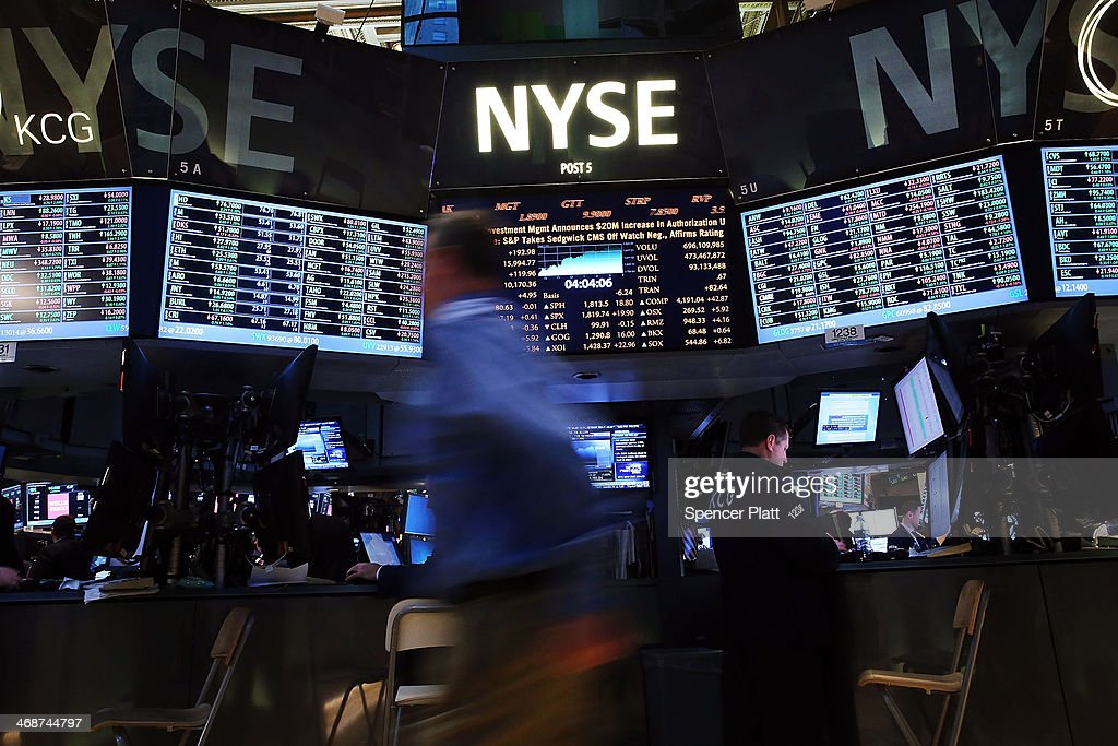 Traders work on the floor of the New York Stock Exchange on February 11 2014 in New York City Following news that monetary policy will not change...