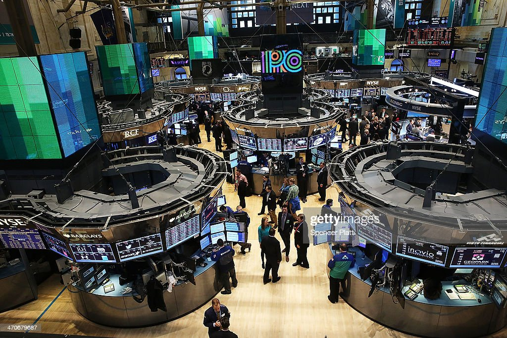 Traders work on the floor of the New York Stock Exchange on February 20 2014 in New York City The Dow Jones industrial average the SP 500 and the...