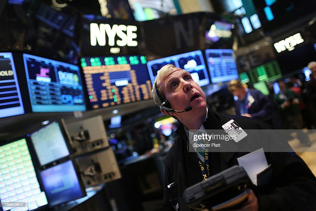 Traders work on the floor of the New York Stock Exchange on January 2, 2013 in New York City. A day after U.S. lawmakers reached a last minute agreement to avert the fiscal cliff, U.S. stocks surged as traders around the globe felt renewed confidence over global markets. Shortly after the opening bell, The Dow Jones Industrial Average rallied more than 230 points, or 1.7%.