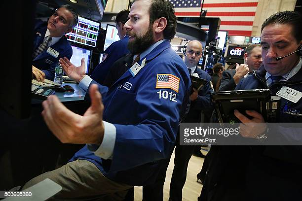 Traders work on the floor of the New York Stock Exchange on January 6 2016 in New York City With increased geopolitical tensions of the situation in...