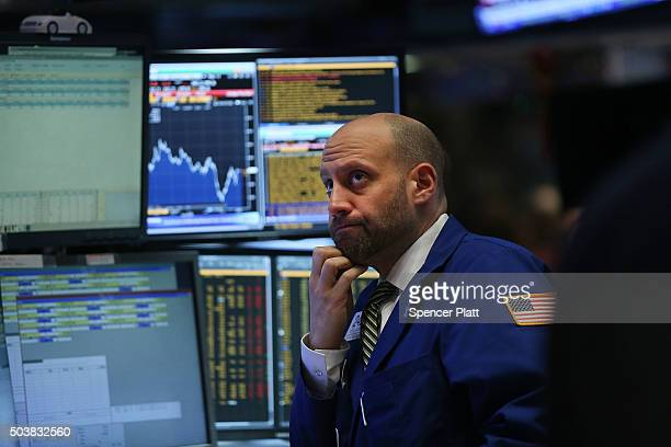 Traders work on the floor of the New York Stock Exchange on January 7 2016 in New York City Chinese stocks plunged on Thursday by more than 7 percent...