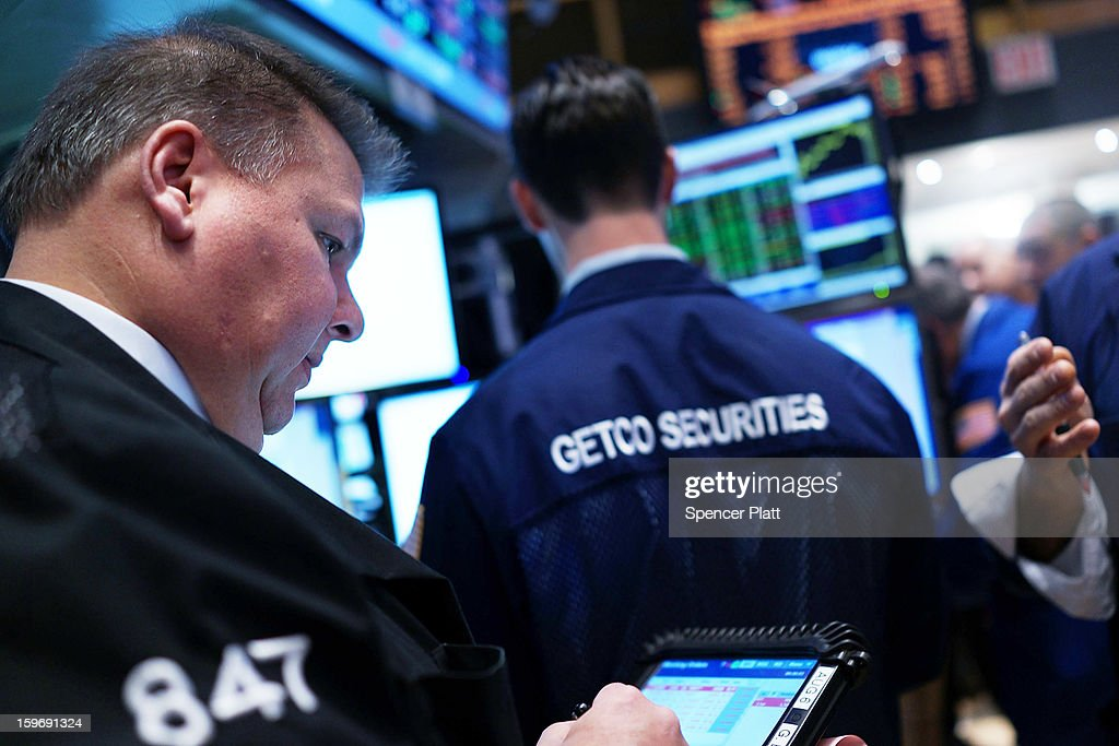 Traders work on the floor of the New York Stock Exchange on January 18, 2013 in New York City. A day after the Standard & Poor's 500-index rose to its highest level in five years, The Dow Jones industrial average was fluctuating between small losses and gains in morning trading.