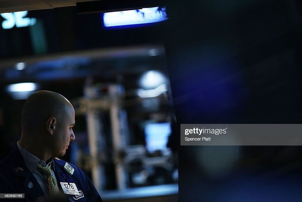 Traders work on the floor of the New York Stock Exchange on January 14, 2014 in New York City. Following a drop in the market on Monday, stocks were up in early trading Tuesday partly boosted by strong results from some of the country's largest financial institutions.