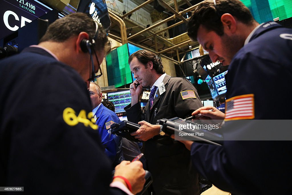 Traders work on the floor of the New York Stock Exchange on January 15, 2014 in New York City. The Dow rallied for a second straight day closing up 108 points.