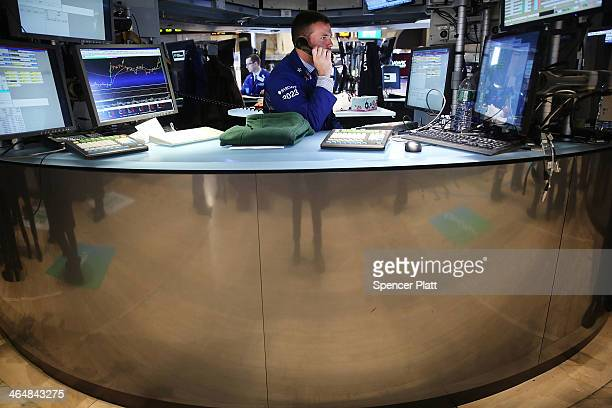 Traders work on the floor of the New York Stock Exchange on January 24 2014 in New York City In morning trading the Dow dropped more than 170 points...