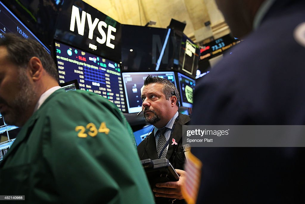 Traders work on the floor of the New York Stock Exchange (NYSE) on July 14, 2014 in New York City. As investors prepare for a series of earnings reports this week, markets started off to a positive start on Monday. The Dow Jones Industrial Average was up 129 points in morning trading.