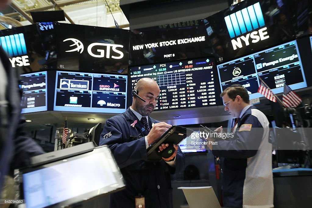 Traders work on the floor of the New York Stock Exchange (NYSE) on June 27, 2016 in New York City. Markets around the globe continue to react negatively to the news that Britain has voted to leave the European Union. The Dow Jones industrial average was down over 200 points in morning trading.
