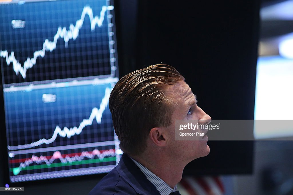 Traders work on the floor of The New York Stock Exchange on March 5, 2013 in New York City. Within the first few minutes of trading Tuesday, the Dow gained nearly 100 points, rising as high as 14,226.20, a new record high.