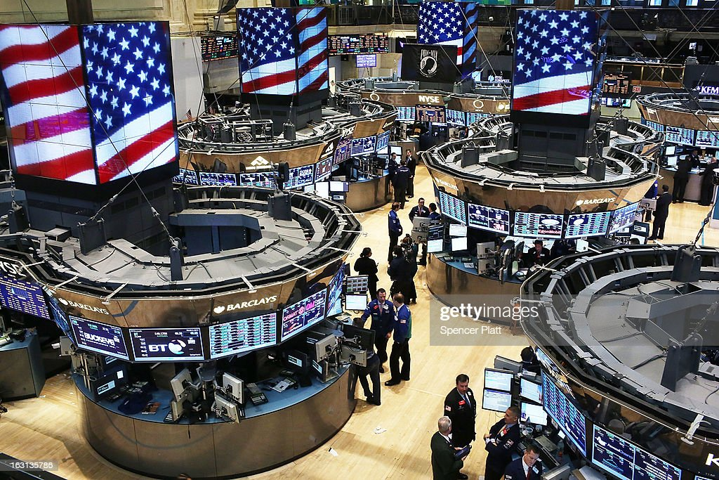 Traders work on the floor of The New York Stock Exchange on March 5 2013 in New York City Within the first few minutes of trading Tuesday the Dow...