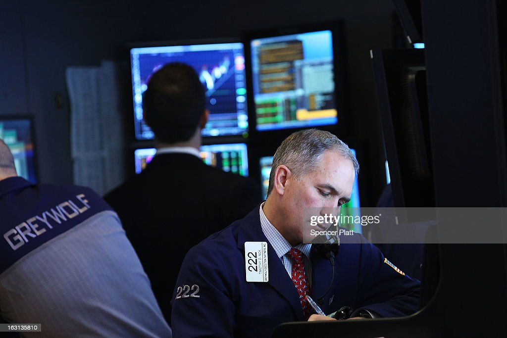 Traders work on the floor of The New York Stock Exchange on March 5, 2013 in New York City. Within the first few minutes of trading Tuesday, the Dow gained nearly 100 points, rising as high as 14,226.20, a new record high