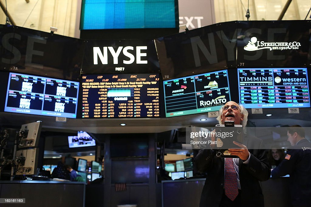 Traders work on the floor of The New York Stock Exchange on March 5, 2013 in New York City. The Dow Jones industrial average rallied to a record high on Tuesday to close for the day at 14,253.77, beating its old 2007 record.