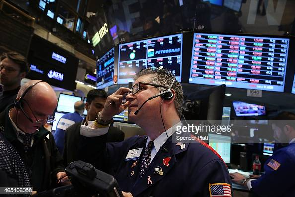 Traders work on the floor of the New York Stock Exchange on March 6 2015 in New York City On fears that the Federal Reserve will soon raise interest...