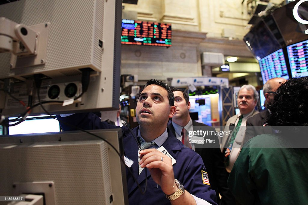 Traders work on the floor of the New York Stock Exchange on May 1, 2012 in New York City. Following positive news of a rise in U.S. manufacturing activity, The Dow Jones industrial average rose almost 66 points, or 0.5%, to close at 13,279.40, the highest since December 2007.