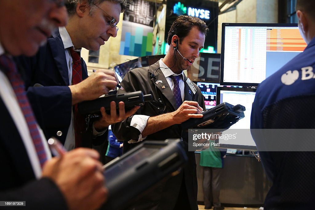 Traders work on the floor of the New York Stock Exchange on May 21, 2013 in New York City. Following comments from a Federal Reserve official indicating that the central bank will continue to flow money into the financial system, stocks rose Tuesday with the Dow Jones industrial average closing up 52.20.