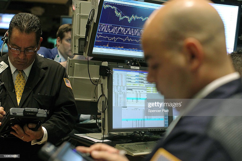 Traders work on the floor of the New York Stock Exchange on May 25, 2010 in New York City. After significant morning losses, the Dow Jones industrial average climbed back in trading to finish down 67 points, or 0.6% for the day. Fears of the continuing European debt crisis and of escalating tension between North and South Korea helped to bring stocks lower.