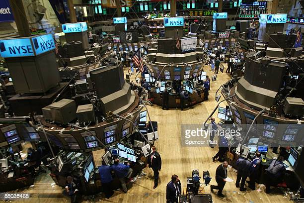 Traders work on the floor of the New York Stock Exchange on May 28 2009 in New York City Stocks turned higher following demand as a Treasury auction...