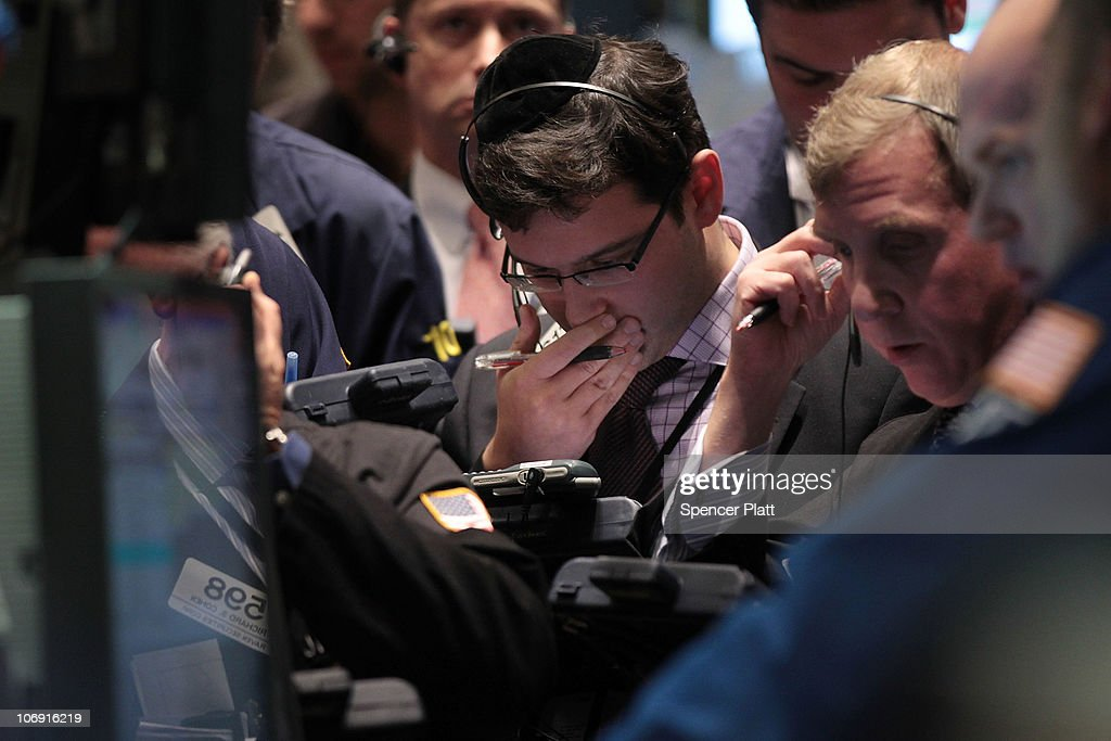 Traders work on the floor of the New York Stock Exchange on November 16, 2010 in New York City. Following continued worries over the economic outlook for Europe, China and the United States, the Dow Jones industrial average (INDU) was down 178 points in a preliminary tally.