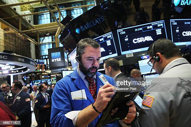 Traders work on the floor of the New York Stock Exchange on November 30 2015 in New York City Following the Thanksgiving holiday in America stocks...
