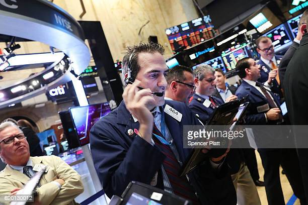 Traders work on the floor of the New York Stock Exchange on November 1 2016 in New York City As Wall Street continues to feel election uncertainty...