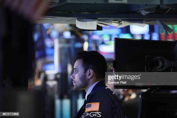 Traders work on the floor of the New York Stock Exchange on October 17 2017 in New York City The Dow Jones Industrial average briefly rose to 23000...