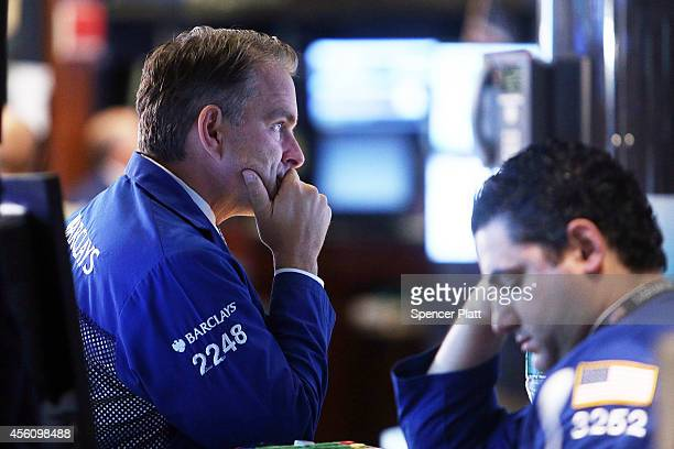 Traders work on the floor of the New York Stock Exchange on September 25 2014 in New York City Trouble in tech stocks resulted in a market selloff on...