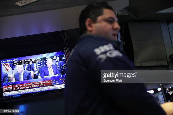 Traders work on the floor of the New York Stock Exchange on the first day of trading after Donald Trump was sworn in as president on January 23 2017...