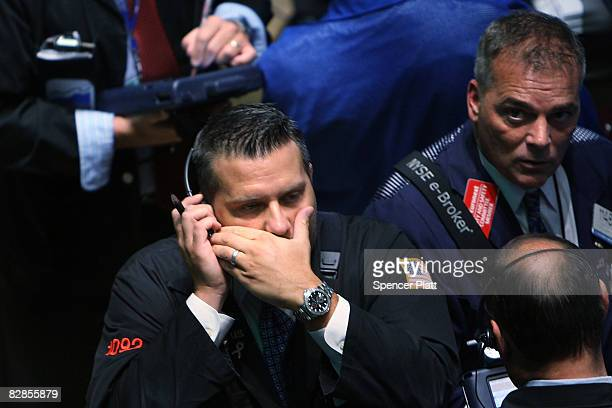 Traders work on the floor of the New York Stock Exchange September 17 2008 in New York City Following news late Tuesday of the US government takeover...