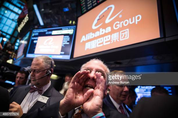 Traders work on the floor of the New York Stock Exchange while the price of Alibaba Group's initial price offering is decided on September 19 2014 in...