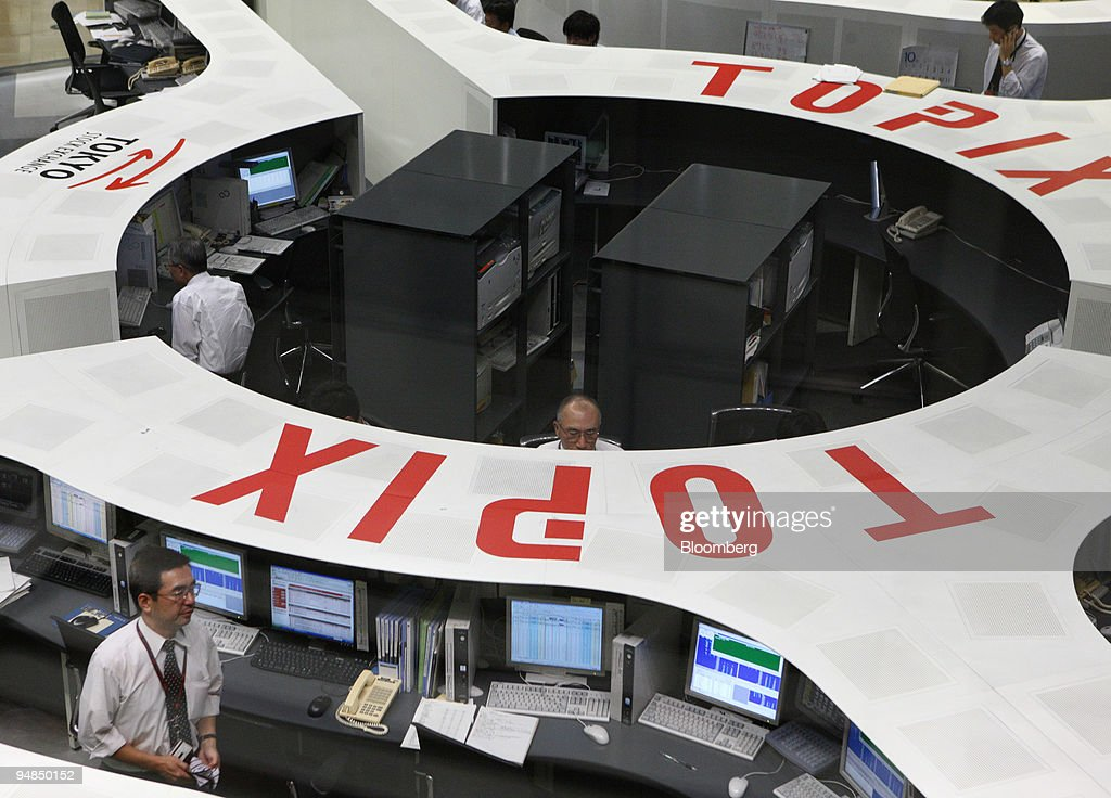 Traders work on the floor of the Tokyo Stock Exchange in Tokyo Japan on Thursday Oct 16 2008 Asian stocks tumbled driving Japan's Nikkei 225 Stock...
