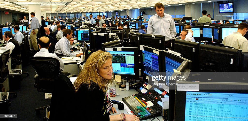 Traders work on the trading floor of JP Morgan Chase February 24 2004 in New York City