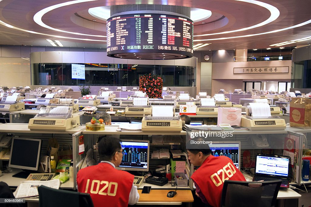 Traders work on the trading floor of the Hong Kong Stock Exchange, operated by Hong Kong Exchanges and Clearing Ltd. (HKEx), during the first day of trading after lunar new year in Hong Kong, China, on Thursday, Feb. 11, 2016. Hong Kong stocks headed for their worst start to a lunar new year since 1994 as a global equity rout deepened amid concern over the strength of the world economy. Photographer: Xaume Olleros/Bloomberg via Getty Images