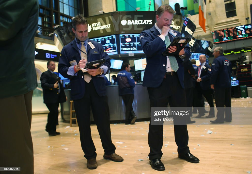 Traders work the floof of the New York Stock Exchange on January 24, 2013 in New York City. The Dow Jones Industrial Average and the S&P both hit 5-year highs January 24, with the Dow closing at 13,825.
