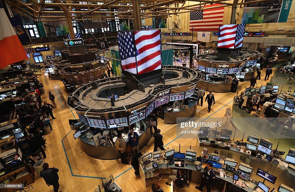 Traders work the floor of the New York Stock Exchange as Federal Reserve Chairman Ben Bernanke speaks on June 20 2012 in New York City Bernanke...