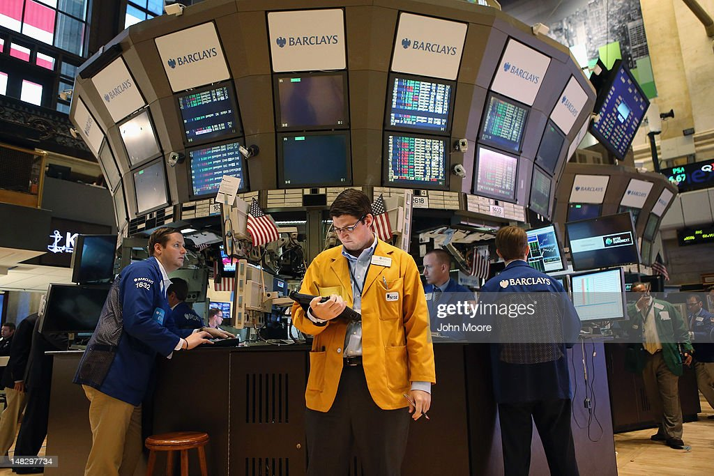 Traders work the floor of the New York Stock Exchange at the end of the trading day on July 13, 2012 in New York City. The Dow Jones Industrial Average rallied July 13, closing up almost 204 points to finish at 12,777. The rally ended a 6-day slump, the longest since mid-May.