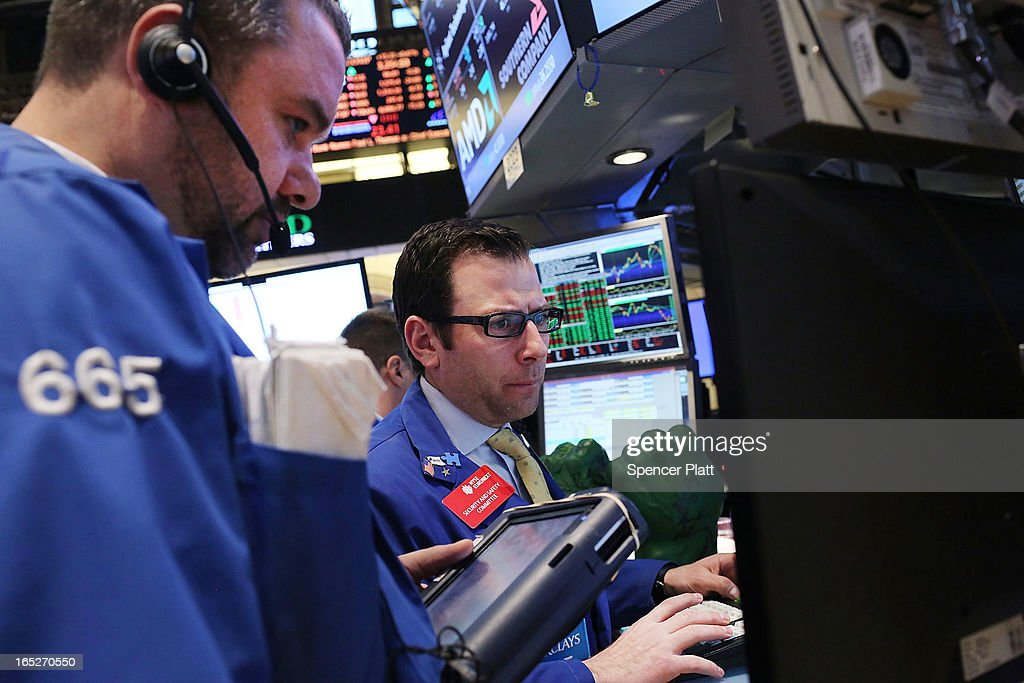 Traders work the floor of the New York Stock Exchange at the end of the trading day on April 2, 2013 in New York City. The Dow Jones Industrial average and the S&P 500 rose to new record highs on April 2, with the Dow finishing at a record close of 14,662. All three major indexes are up between about 10 percent and 12 precent for the year.