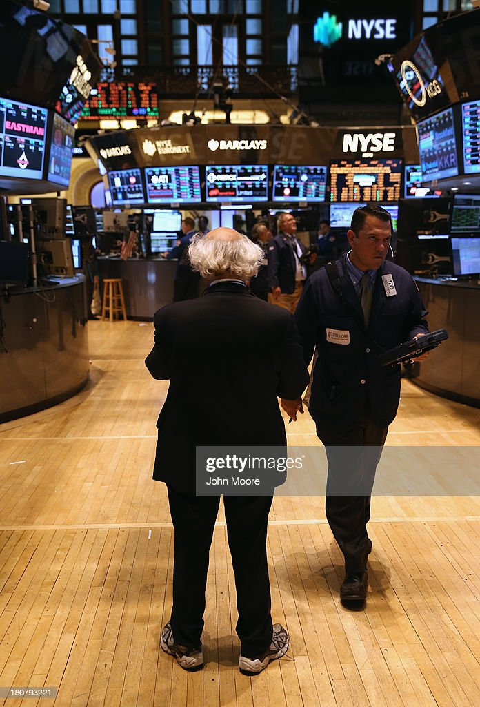 Traders work the floor of the New York Stock Exchange on September 16, 2013 in New York City. The Dow Jones Industrial Average traded up 119 points, closing at 15,495. Five years after the beginning of the financlial crisis, Wall Street has more than recovered its losses, although unemployment nationwide remains high.