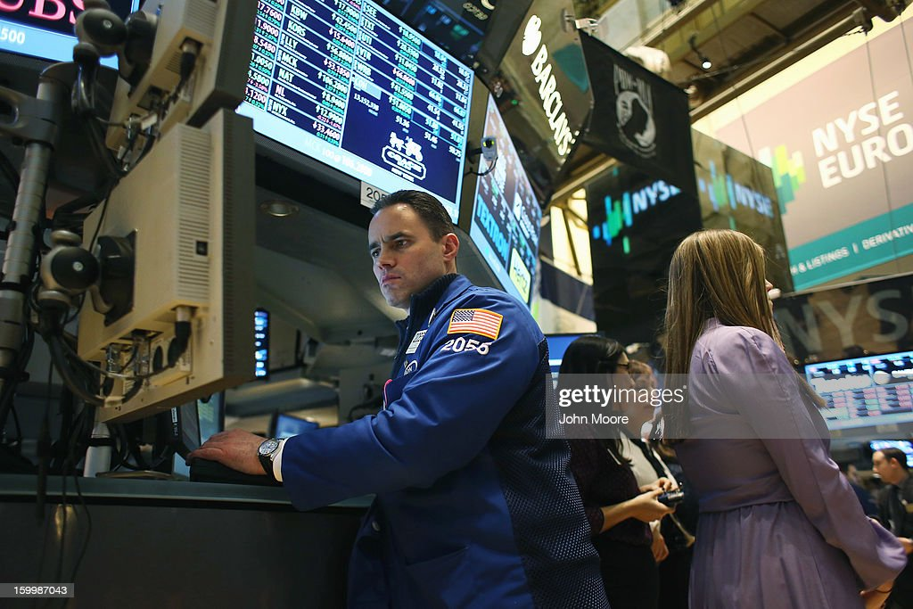 A traders works the floor of the New York Stock Exchange at the end of the trading day on January 24, 2013 in New York City. The Dow Jones Industrial Average and the S&P both hit 5-year highs January 24, with the Dow closing at 13,825.