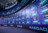 Trading activity is displayed on electronic boards at the Nasdaq MarketSite in New York US on Friday March 18 2011 Nasdaq OMX Group Inc is in talks...