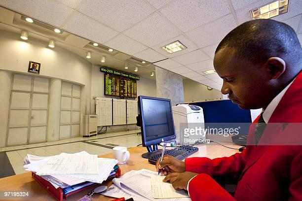 Trading assistant Henry Njologoat works at the Nairobi Stock Exchange in Nairobi Kenya on Thursday Feb 25 2010 Kenya National Bureau of Statistics...