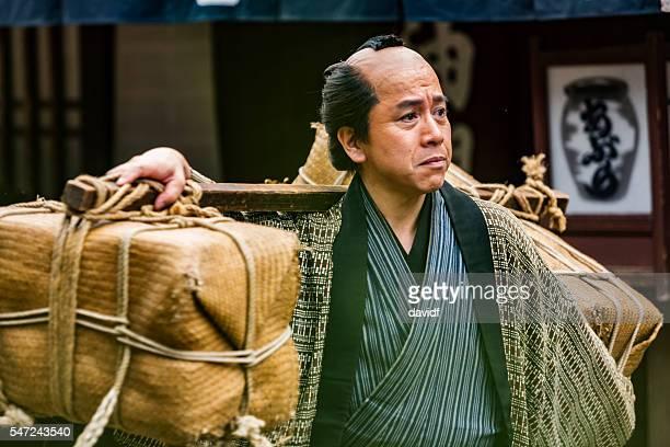 Tradional Japanese Farmer Taking Produce to Market