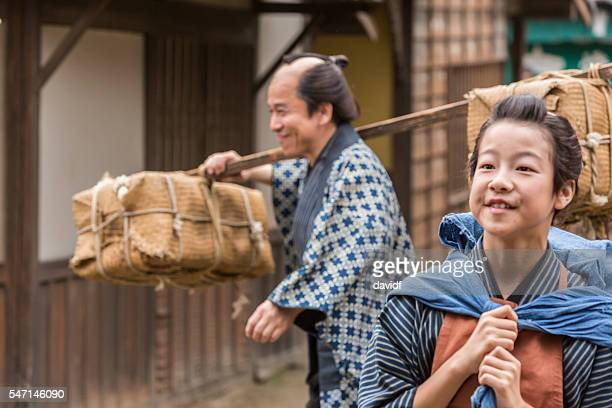 Tradional Japanese Father and Son Farmers Taking Produce to Market