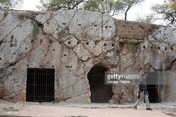 Tradition dictates that one of these three recesses at the base of Filopapu Hill in Athens Greece served as Socrates' jail cell The bars are a modern...