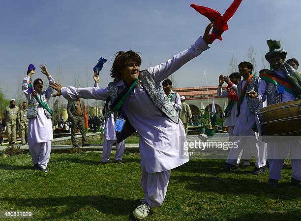 A traditional Afghan dancer performs during the official Nawroz festivities at the Presidential Palace in Kabul on March 27 2014 Nawroz the Persian...