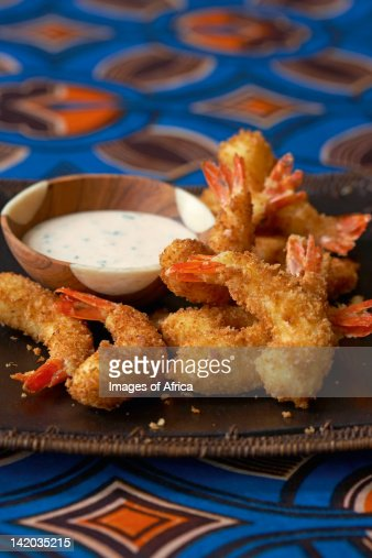 Traditional African cooking. Tiger prawns with peri-peri dip