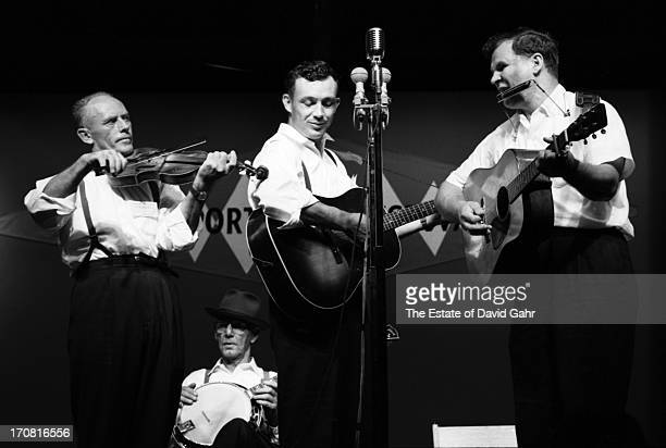 Traditional and oldtimey folk musicians including fiddler Fred Price banjoist musician and singer Clarence Ashley guitarist and singer Clint Howard...