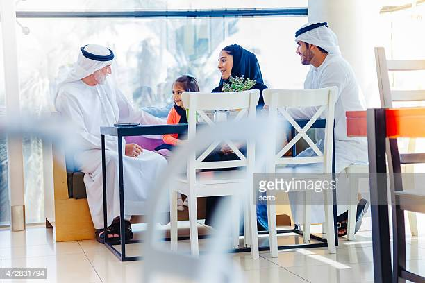Traditional Arab family enjoying at cafe