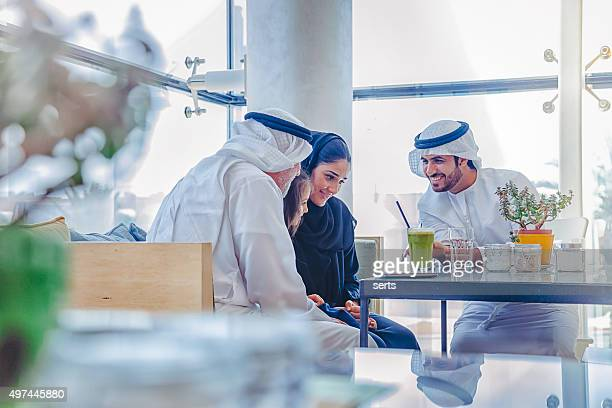 Traditional Arab family enjoying at cafe