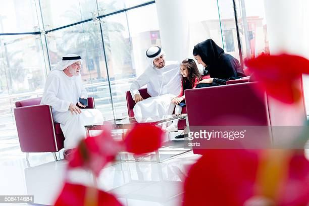 Traditional  Arabic family enjoying at lounge