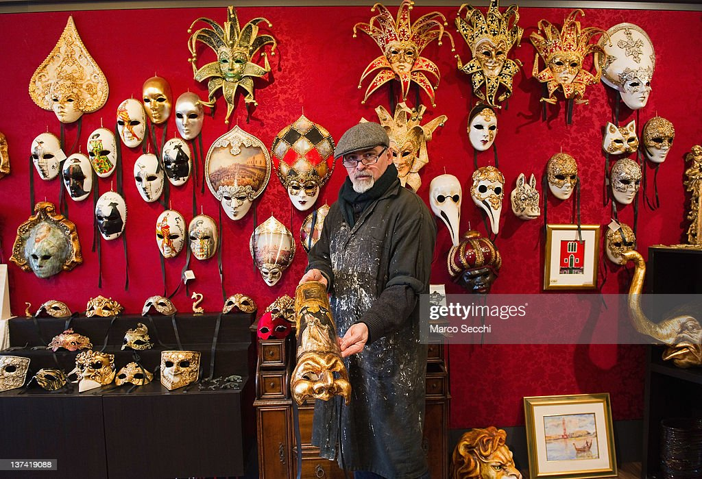 A traditional artisan shows one of the masks on display at his workshop at La Giudecca on January 20, 2012 in Venice, Italy. Traditional venetian mask makers are preparing for their busiest period of the year as the Carnival of Venice approaches. The carnival, which last nearly 3 weeks, will see the streets and canals of Venice filled with people wearing highly-decorative and imaginative carnival costumes and masks.
